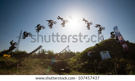 BRATISLAVA, SLOVAKIA - APRIL 28: jump sequence of Frantisek Maca (CZE) performing trick at FMX session on April 28, 2012 in Bratislava, Slovakia (Multiple Exposure) - stock photo