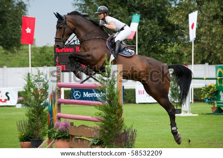 BRATISLAVA, SLOVAKIA - AUGUST 5:  HUGYECZ Mariann on horse CASH 51 in action during first round of qualification to Grand Prix CSIO-W*** August 5, 2010 in Bratislava, Slovakia - stock photo