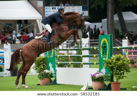 BRATISLAVA, SLOVAKIA - AUGUST 5: RENDEMLEONTTER Johan on horse NOVA ZONNESTRAAL in action during first round of qualification to Grand Prix CSIO-W*** August 5, 2010 in Bratislava, Slovakia - stock photo