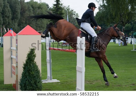 BRATISLAVA, SLOVAKIA - AUGUST 5: SULEK Igor on horse WAVO PROFIT in action during first round of qualification to Grand Prix CSIO-W*** August 5, 2010 in Bratislava, Slovakia - stock photo