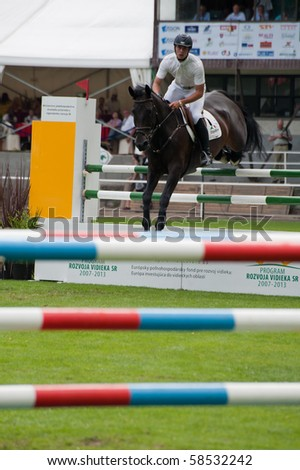BRATISLAVA, SLOVAKIA - AUGUST 5: WINGRAVE Jamie on horse AGROPOINT CALIRA in action during first round of qualification to Grand Prix CSIO-W*** August 5, 2010 in Bratislava, Slovakia - stock photo