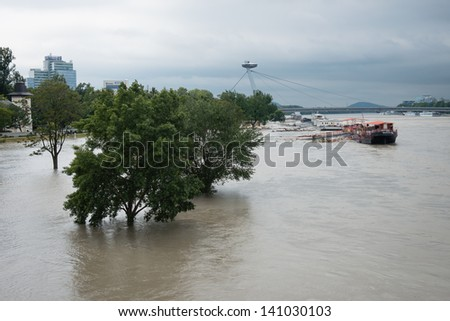 BRATISLAVA, SLOVAKIA - JUNE 4:  The whole Tyrsovo Embankment is flooded. The level of the Danube in Bratislava exceeded 900 cm on June 4, which triggered a 3rd-degree flood warning. - stock photo