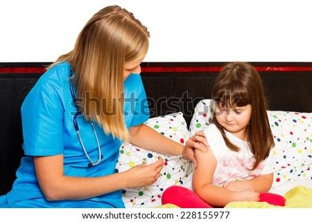Brave little patient receiving injection from her pediatrician. - stock photo