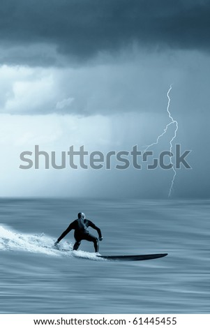 brave surfer looking the incoming storm - stock photo