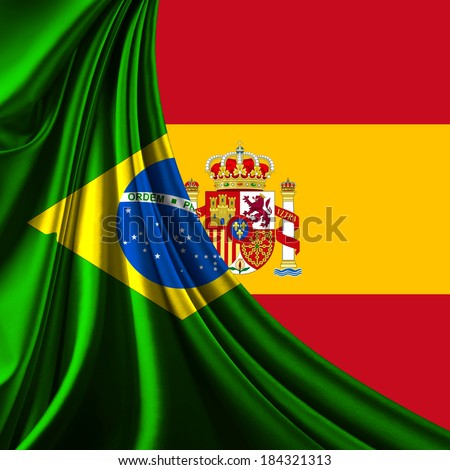 Brazil flag fabric and spain flag background - stock photo