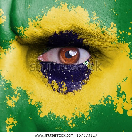 Brazil flag painted on angry man face - stock photo