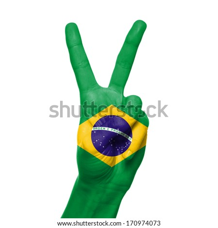 Brazil flag painted on hand over white background - stock photo