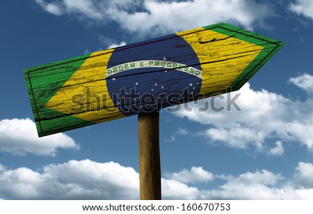 Brazil flag wooden sign with a beautiful sky on background - Latin America - stock photo