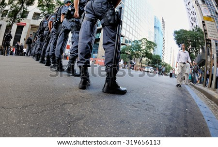 Brazil - July 11, 2013: Riot police in formation shortly before the protest at Rio Branco Avenue, Rio's main street in downtown. - stock photo