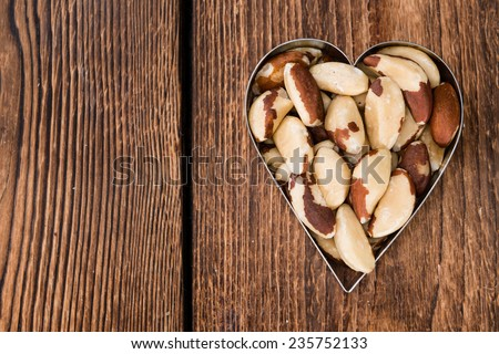 Brazil Nuts (detailed close-up shot) on an old vintage background - stock photo