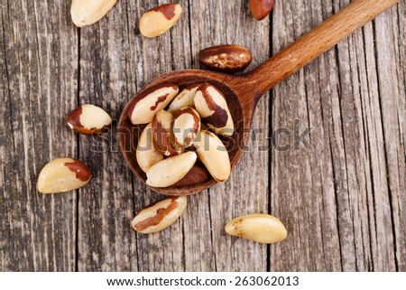 Brazil nuts on a wooden spoon. - stock photo