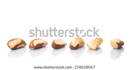 Brazil nuts over white background - stock photo