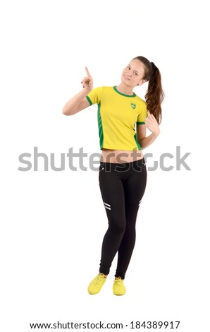 Brazil sports fan pointing up. Attractive sportive girl with Brazilian flag on her yellow t-shirt. Isolated on white. - stock photo