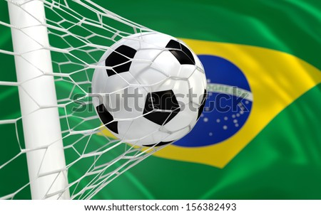 Brazil waving flag and soccer ball in goal net  - stock photo