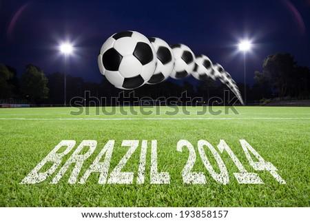 brazil 2014 written on soccer field and spot lights - stock photo
