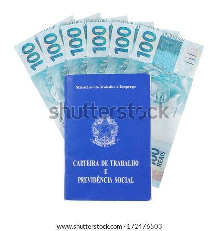 Brazilian document work and social security (Carteira de Trabalho e Previdencia Social) and six hundred reais, brazilian money - stock photo