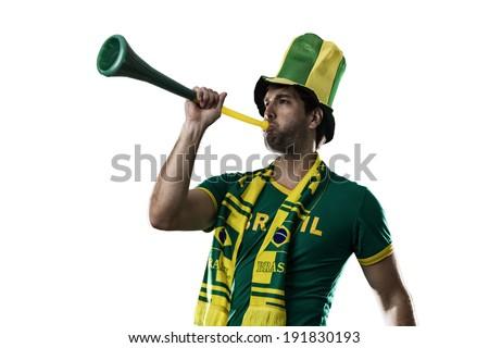 Brazilian Fan Celebrating, on a white background. - stock photo