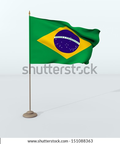 brazilian flag hoisted on the mast - stock photo