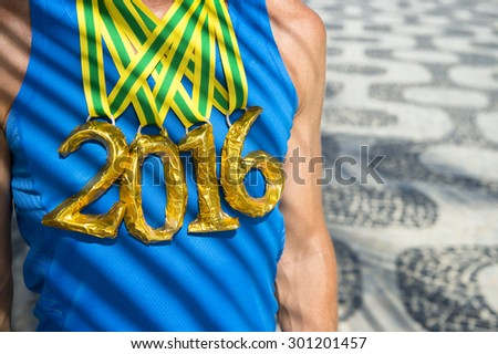 Brazilian gold medal 2016 first place athlete standing with palm frond shadows at the Ipanema Beach sidewalk in Rio de Janeiro Brazil - stock photo
