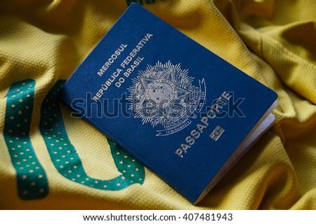 Brazilian Passport on yellow background - stock photo
