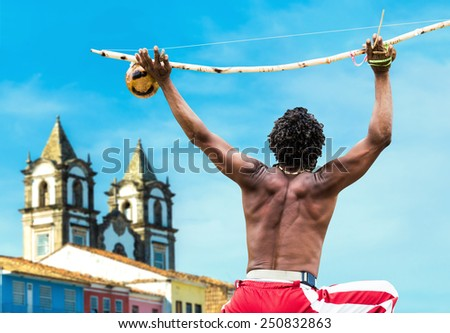 Brazilian performing Capoeira with Berimbau Instrument in Salvador, Bahia, Brazil. - stock photo