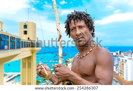 Brazilian playing Berimbau Instrument in Salvador, Bahia, Brazil - stock photo