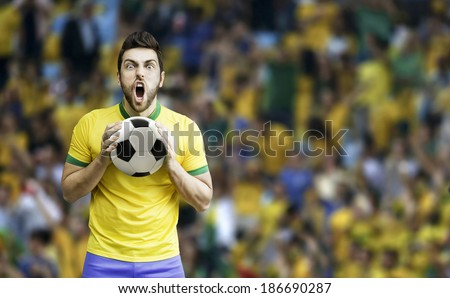 Brazilian soccer player celebrates on the stadium - stock photo