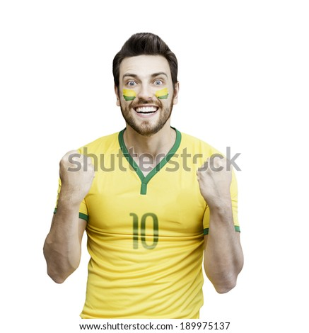 Brazilian soccer player celebrates on white background - stock photo