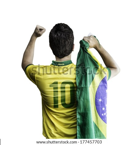 Brazilian soccer player holding the flag of Brazil celebrates on white background - stock photo