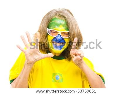 Brazilian sport fan making 6 with the fingers - stock photo