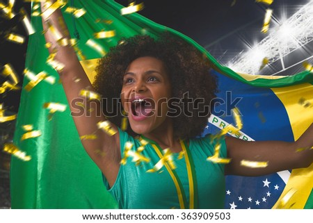 Brazilian woman celebrating in the stadium - stock photo