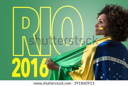 Brazilian woman holding the flag of Brazil and the Text: Rio - stock photo