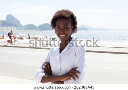 Brazilian woman with crossed arms at Rio de Janeiro - stock photo