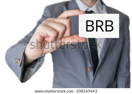 BRB. Businessman in suit with a black tie showing or holding business card  - stock photo
