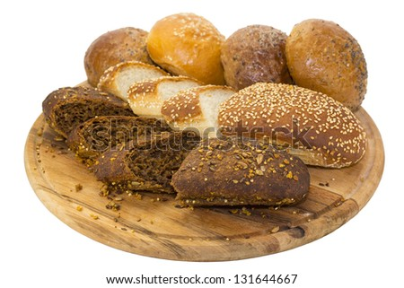 bread and buns on wooden plate - stock photo