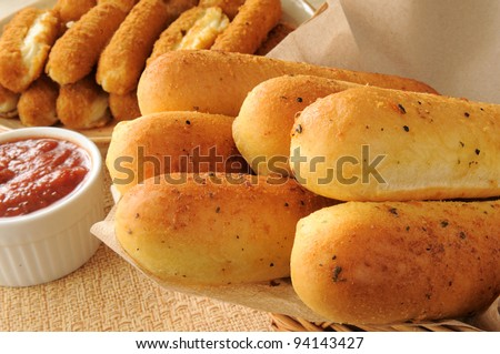 Bread and cheese sticks with spaghetti sauce - stock photo