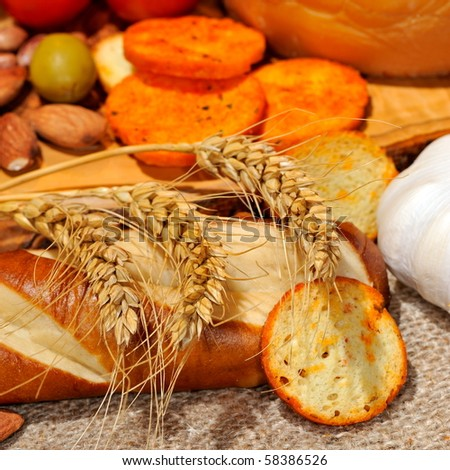 bread and dried wheat - stock photo