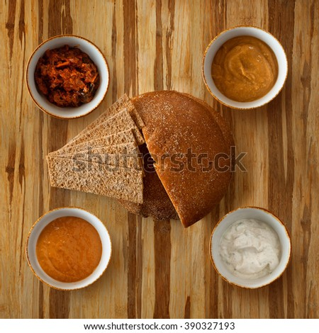 bread and spices on wooden table surface - stock photo