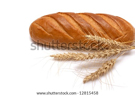 Bread and wheat on a white background - stock photo