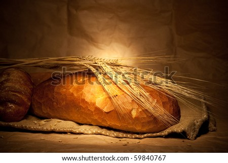 bread and wheat on sacking still-life - stock photo