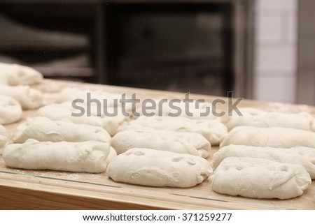 Bread before placing in hot oven. - stock photo