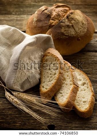 bread ear and flour - stock photo