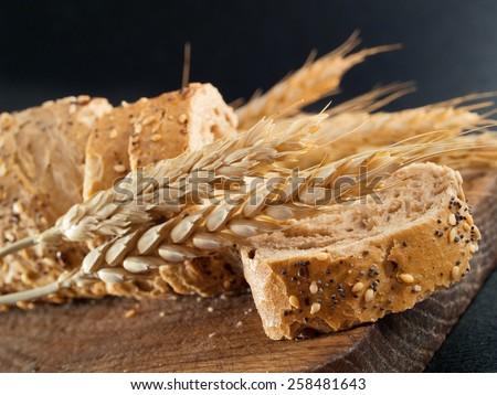 Bread isolated on black - stock photo