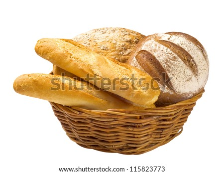 Bread loaves and baguettes in a wicker basket - stock photo