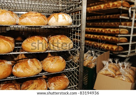 Bread making in factory - stock photo