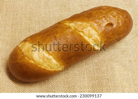Bread on a burlap background. Selective focus - stock photo
