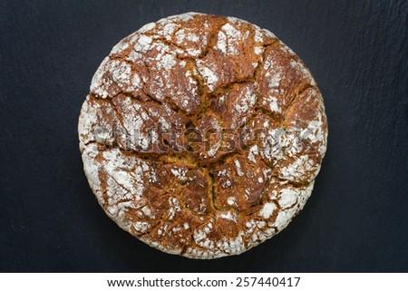 bread on black background - stock photo