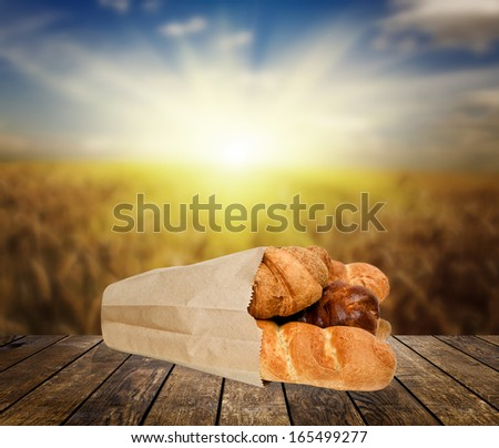 bread on the wood textured backgrounds in a room interior on the sky field  backgrounds - stock photo