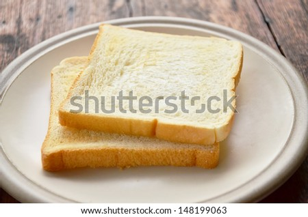 Bread on white dish. - stock photo
