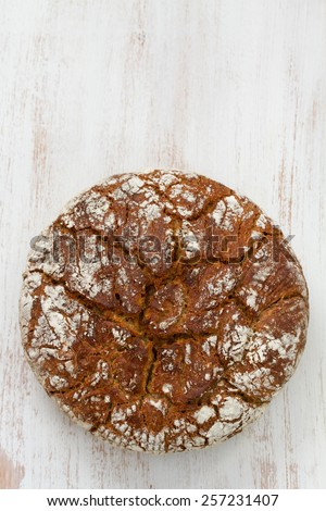 bread on white wooden background - stock photo